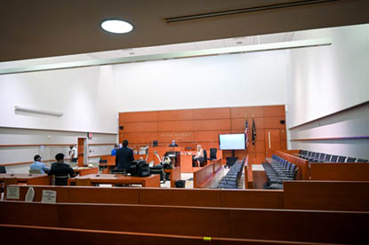 Courtroom with people in  it