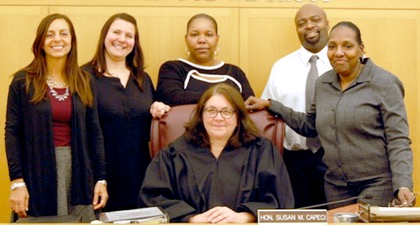 From left to right: SCO Michael Napolitano, Resource Coordinator Taryn Harris, Court Attorney Linda Capitti, Judge Tandra L. Dawson, IDV Coordinator Gail Fleming, Sgt. Betty Santiago, Senior Court Clerk John Montero, and Officer Kerri-Ann Laird.